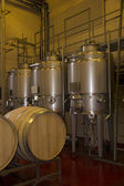 Wine making vats and equipment in tour of winery — Stock Photo