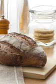 Homemade Tradition bread loaf on the kitchen table — Stock Photo