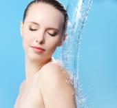 Beautiful girl and stream of water — Stock Photo