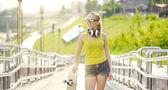 Teenage girl with skateboard — Stock Photo