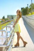 Girl in a yellow dress — Stock Photo