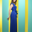 Attractive girl in a long dress — Stock Photo #63889059