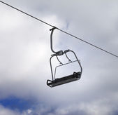 Chair-lift and cloudy sky — Stock Photo
