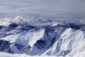 Winter mountains in clouds at windy day — Stock Photo