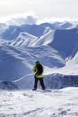 Snowboarder on top of off-piste slope — Stock Photo
