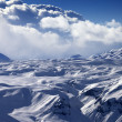 Snowy sunlight plateau and blue sky with clouds — Stock Photo #54725345