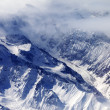 Top view on snow mountains and glacier in mist — Stock Photo #54986973