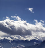 Evening sunlight mountains in clouds — Stock Photo