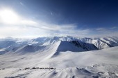Off-piste slope and sky with sun — Stock Photo