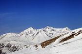 Ski slope and snowy mountains — Stock Photo