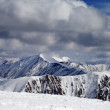 Winter snowy mountains in clouds — Stock Photo #56933035
