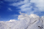 Off-piste slope at evening and sky with clouds — Stock Photo