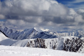 Winter snowy mountains in clouds — Stock Photo