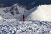 Skier on off-piste slope in sun evening — Stock Photo