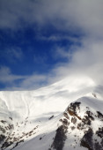 View on off-piste sunlight slope in clouds — Stock Photo