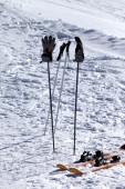 Skiing equipment on ski slope at sun day — Stock Photo