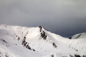 Off-piste slope and gray sky in wind day — Stock Photo