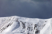 Off-piste slope and storm gray clouds — Stock Photo