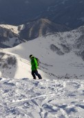 Snowboarder on off-piste slope in sun evening — Stock Photo