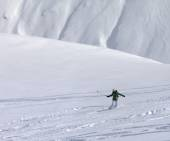Snowboarder downhill on off piste slope with newly fallen snow — Stock Photo