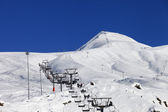 Winter mountains and ski slope at nice sun day — ストック写真