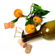 Empty bottle of wine, corks, muselet and mandarins — Stock Photo #60935421