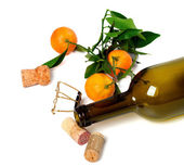 Empty bottle of wine, corks, muselet and mandarins — Stock Photo