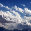 Helicopter in cloudy sky — Stock Photo #62546293