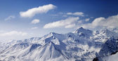 Snowy winter mountains in sun day. Panoramic view. — Photo