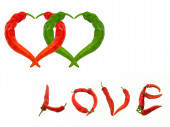 Two hearts and word Love composed of red and green chili peppers — Стоковое фото