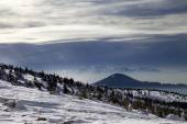 Winter mountains and cloudy sky — Stock Photo