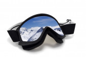 Ski goggles with reflection of mountains at sun day — Stock Photo