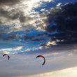 Two silhouette of power kites at sunset sky — Stock Photo #69650513