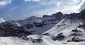 Panoramic view on snowy rocks — Stock Photo