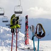 Protective sports equipments on ski poles at ski resort — Stock Photo