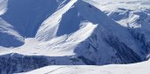 Snow off-piste slope in high mountains — Stock Photo