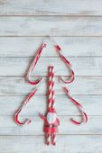 Christmas greeting card with candy canes and Santa Claus — Stock Photo