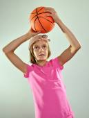 Child playing basketball and throwing ball — Stock Photo