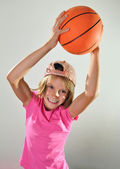 Child exercising with a ball — Stock Photo