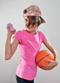 Child exercising with dumbbells and ball — Stock Photo
