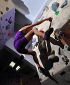 Child exercising and rock climbing — Stock Photo