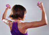 Child exercising with dumbbells — Stock Photo
