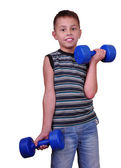 Isolated portrait of child exercising with dumbbells  — Foto de Stock