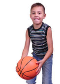 Smiling boy, basketball player posing with a ball — Stock Photo