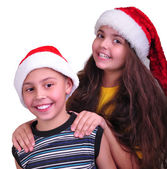 Happy children with Santa Claus red hats — Stock Photo