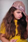 Cool teen age girl with a cap posing and gesturing — Stock Photo