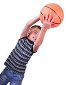 Boy, basketball player makes a throw with a ball — Stock Photo