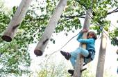 Child in a climbing adventure activity park — Stock Photo