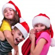 Group of happy children with Santa Claus red hats — Stock Photo #54188185
