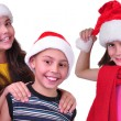 Happy children friends with Santa Claus red hats — Stock Photo #54188667